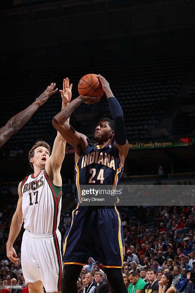 Paul George #24 of the Indiana Pacers shoots against Mike Dunleavy #17 of the Milwaukee Bucks during the game on December 18, 2012 at the BMO Harris Bradley Center in Milwaukee, Wisconsin.