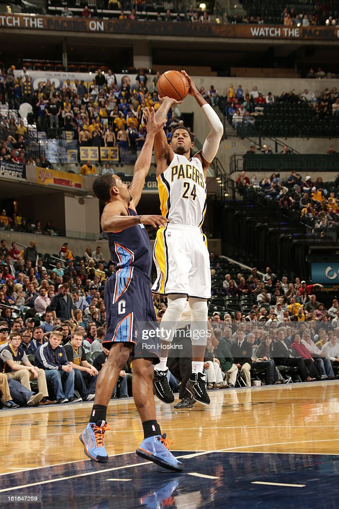 Paul George #24 of the Indiana Pacers shoots against <a gi-track='captionPersonalityLinkClicked' href=/galleries/search?phrase=Ramon+Sessions&family=editorial&specificpeople=805440 ng-click='$event.stopPropagation()'>Ramon Sessions</a> #7 of the Charlotte Bobcats on February 13, 2013 at Bankers Life Fieldhouse in Indianapolis, Indiana.
