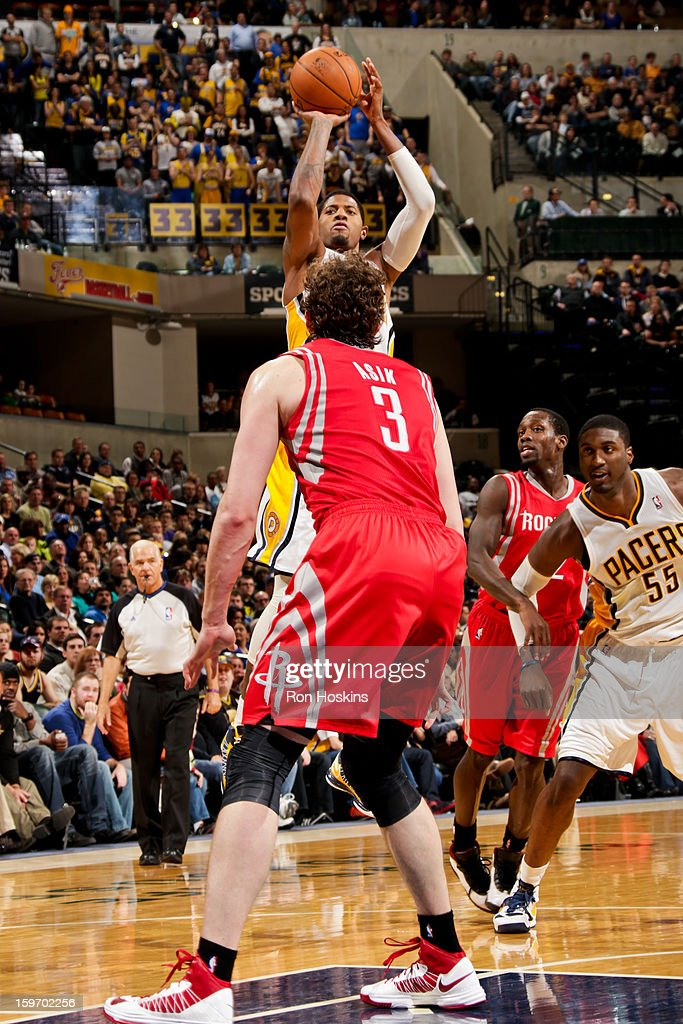 Paul George #24 of the Indiana Pacers shoots against the Houston Rockets on January 18, 2013 at Bankers Life Fieldhouse in Indianapolis, Indiana.