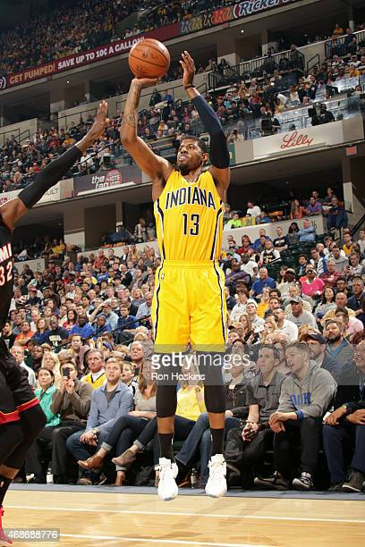 Paul George of the Indiana Pacers shoots against the Miami Heat at Bankers Life Fieldhouse on April 5 2015 in Indianapolis Indiana NOTE TO USER User...