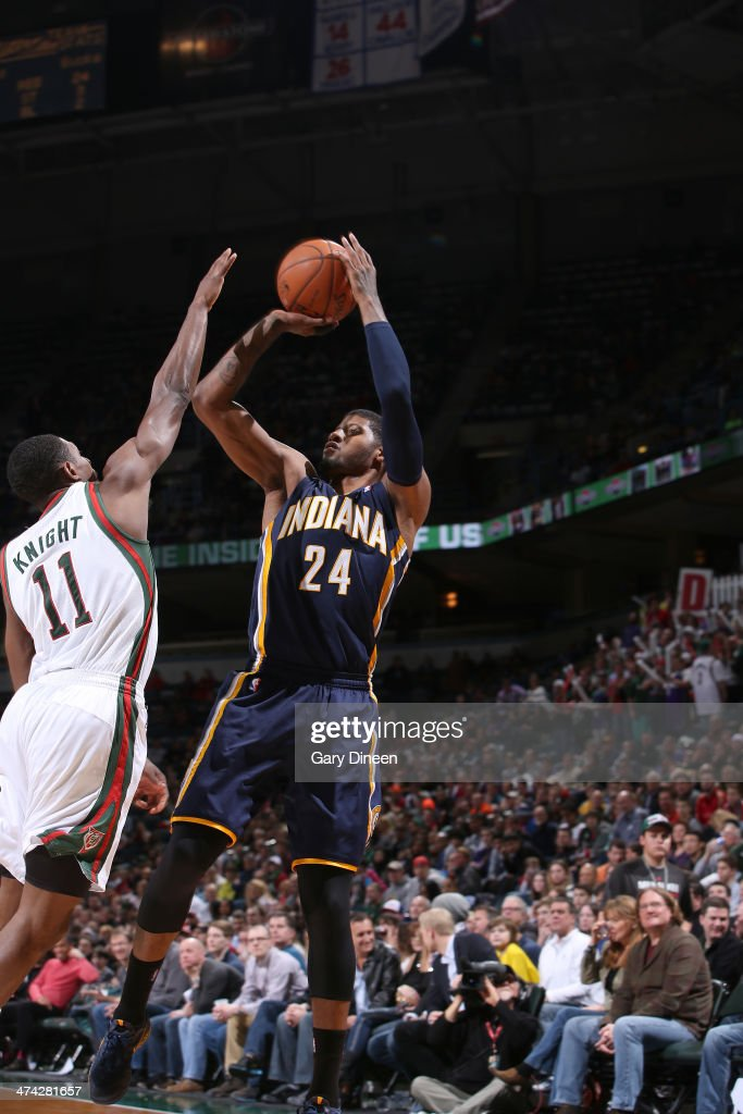 Paul George #24 of the Indiana Pacers shoots against the Milwaukee Bucks on February 22, 2014 at the BMO Harris Bradley Center in Milwaukee, Wisconsin.
