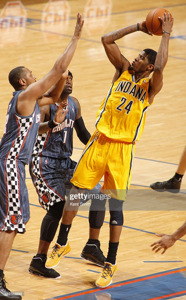 Paul George #24 of the Indiana Pacers shoots over <a gi-track='captionPersonalityLinkClicked' href=/galleries/search?phrase=Boris+Diaw&family=editorial&specificpeople=201505 ng-click='$event.stopPropagation()'>Boris Diaw</a> #32 of the Charlotte Bobcats on March 23, 2011 at Time Warner Cable Arena in Charlotte, North Carolina.