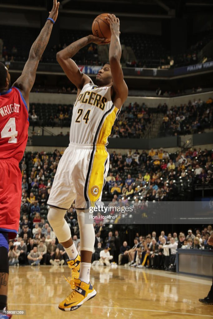Paul George #24 of the Indiana Pacers shoots the ball against <a gi-track='captionPersonalityLinkClicked' href=/galleries/search?phrase=Dorell+Wright&family=editorial&specificpeople=211344 ng-click='$event.stopPropagation()'>Dorell Wright</a> #4 of the Philadelphia 76ers on December 14, 2012 at Bankers Life Fieldhouse in Indianapolis, Indiana.