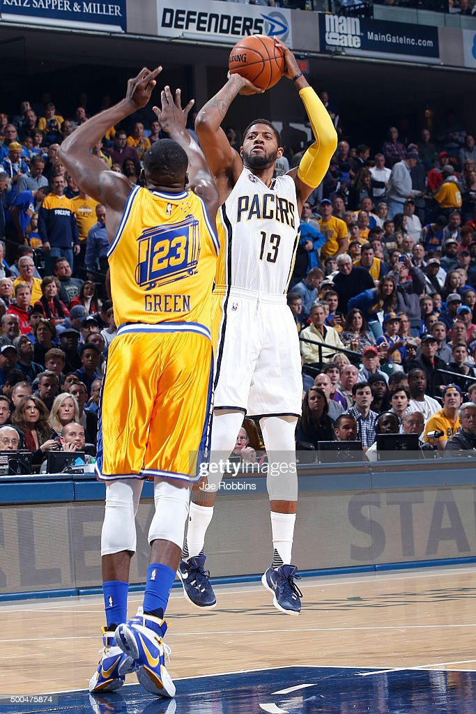 Paul George of the Indiana Pacers shoots the ball against Draymond Green of the Golden State Warriors in the first half of the game at Bankers Life...