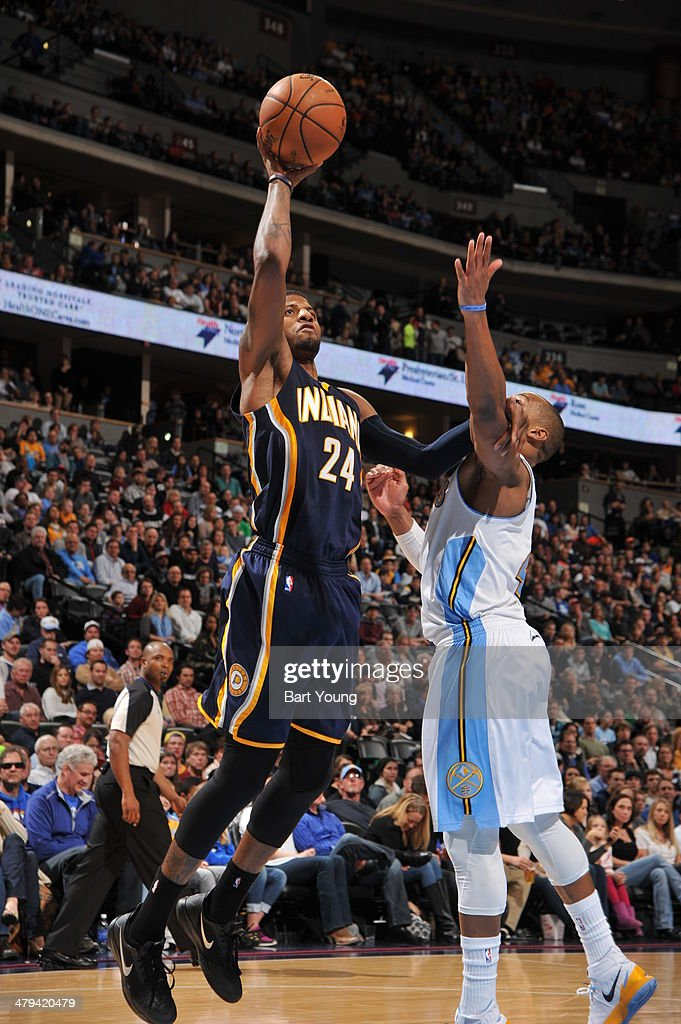 Paul George #24 of the Indiana Pacers shoots the ball against the Denver Nuggets on January 25, 2014 at the Pepsi Center in Denver, Colorado.