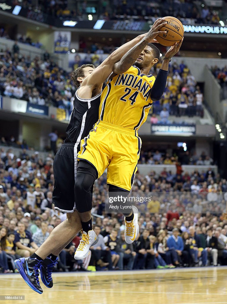 Paul George #24 of the Indiana Pacers shoots the ball while defended by <a gi-track='captionPersonalityLinkClicked' href=/galleries/search?phrase=Kris+Humphries&family=editorial&specificpeople=209199 ng-click='$event.stopPropagation()'>Kris Humphries</a> #43 of the Brooklyn Nets at Bankers Life Fieldhouse on April 12, 2013 in Indianapolis, Indiana.