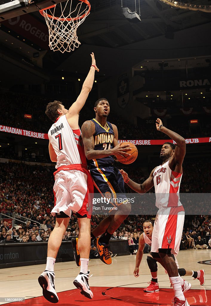 Paul George #24 of the Indiana Pacers shoots the basketball against Andrea Bargnani #7 of the Toronto Raptors during the game on December 28, 2011 at the Air Canada Centre in Toronto, Ontario, Canada.