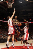 Paul George of the Indiana Pacers shoots the basketball against Andrea Bargnani of the Toronto Raptors during the game on December 28 2011 at the Air...