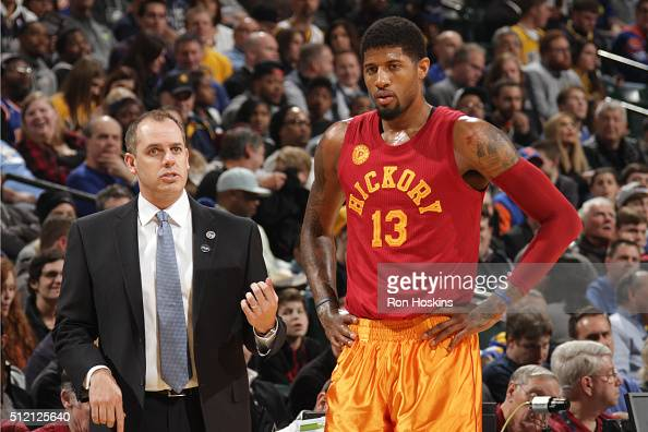 Paul George of the Indiana Pacers speaks with head coach Frank Vogel during the game against the New York Knicks on February 24 2016 at Bankers Life...