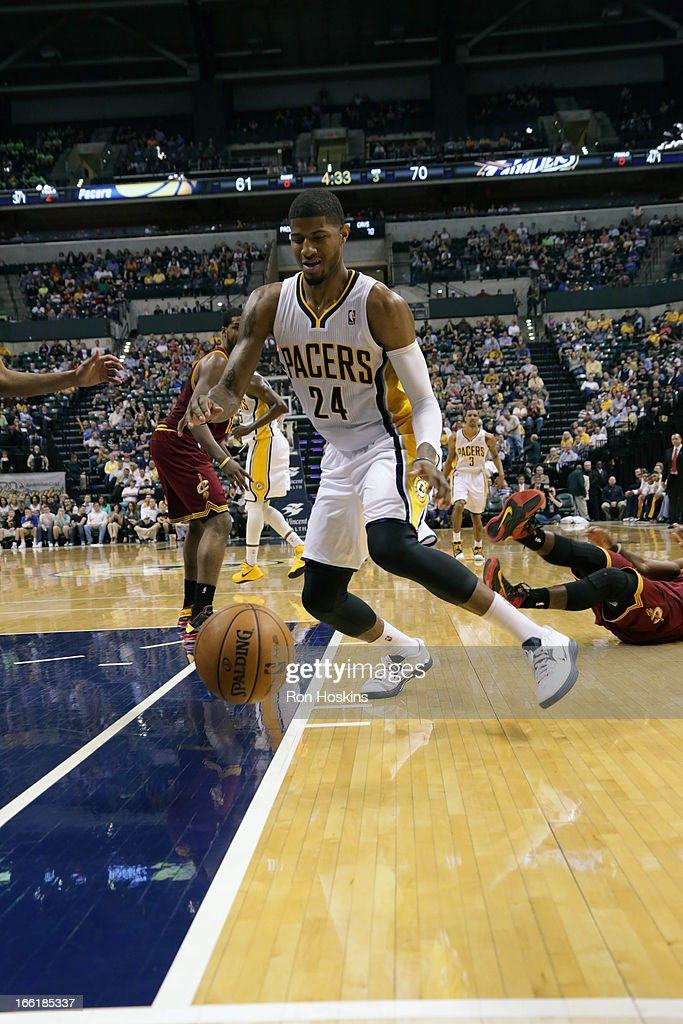 Paul George #24 of the Indiana Pacers splits the defense drives to the hoop against the Cleveland Cavaliers on April 8, 2013 at Bankers Life Fieldhouse in Indianapolis, Indiana.