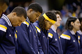 Paul George of the Indiana Pacers stands on the court for the national anthem before the start of the game against the Miami Heat at Bankers Life...