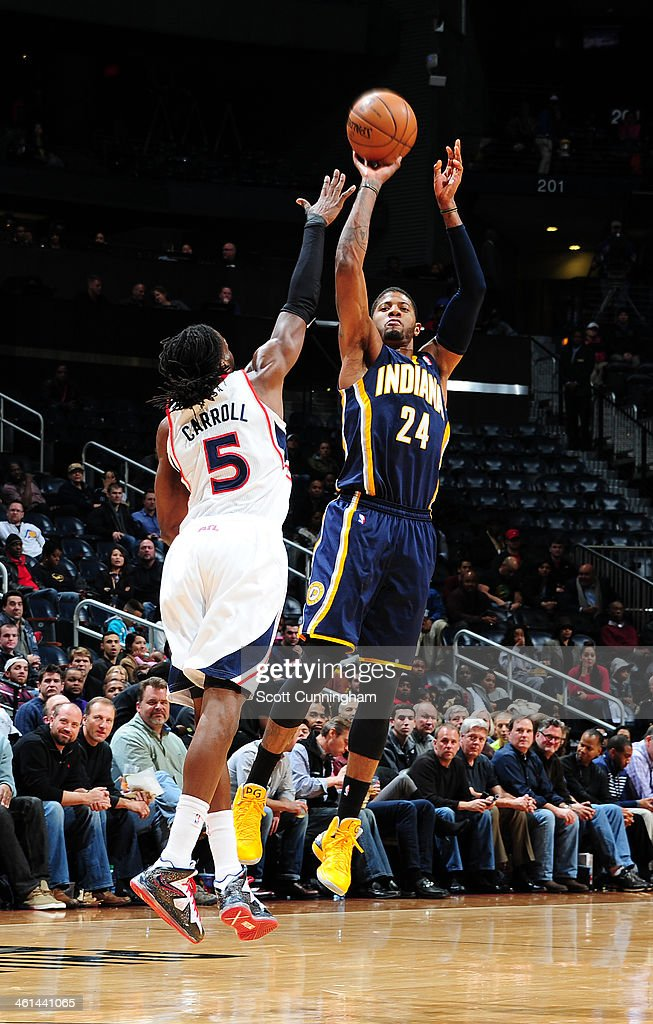 Paul George #24 of the Indiana Pacers taking a shot against the Atlanta Hawks of the Atlanta Hawks against of the Indiana Pacers on January 8, 2014 at Philips Arena in Atlanta, Georgia.