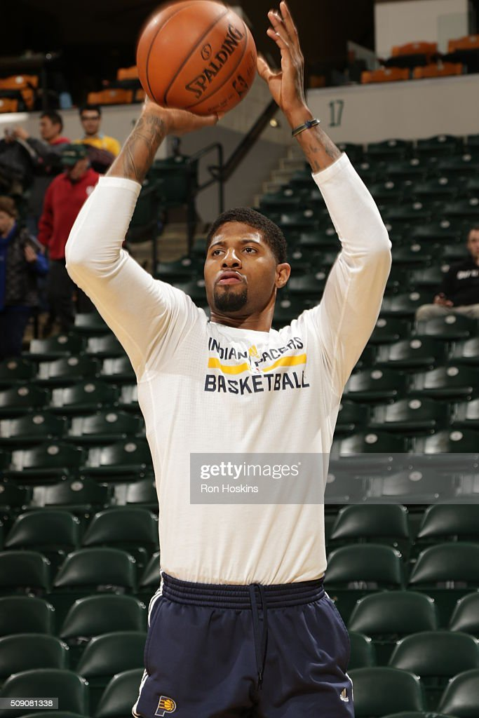 <a gi-track='captionPersonalityLinkClicked' href=/galleries/search?phrase=Paul+George+-+Jugador+de+baloncesto&family=editorial&specificpeople=7235030 ng-click='$event.stopPropagation()'>Paul George</a> #13 of the Indiana Pacers warms up before the game against the Los Angeles Lakers on February 8, 2016 at Bankers Life Fieldhouse in Indianapolis, Indiana.