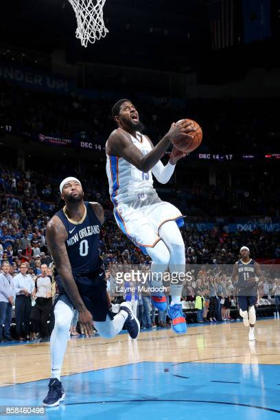 Paul George of the Oklahoma City Thunder goes for a dunk during the game against the New Orleans Pelicans during a preseason game on October 6 2017...
