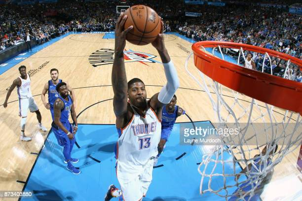 Paul George of the Oklahoma City Thunder goes up for a dunk against the Dallas Mavericks on November 12 2017 at Chesapeake Energy Arena in Oklahoma...