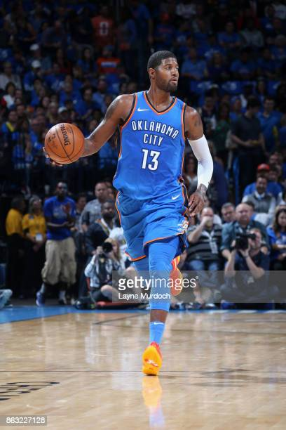 Paul George of the Oklahoma City Thunder handles the ball against the New York Knicks on October 19 2017 at Chesapeake Energy Arena in Oklahoma City...