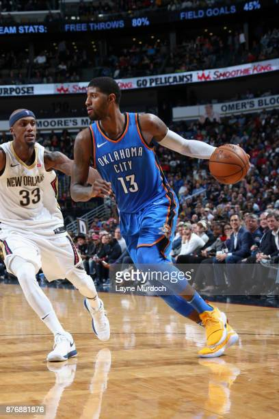 Paul George of the Oklahoma City Thunder handles the ball against the New Orleans Pelicans on November 20 2017 at the Smoothie King Center in New...