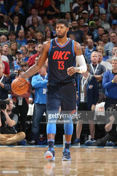 Paul George of the Oklahoma City Thunder handles the ball against the San Antonio Spurs on December 3 2017 at Chesapeake Energy Arena in Oklahoma...