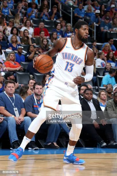Paul George of the Oklahoma City Thunder handles the ball during the game against the New Orleans Pelicans during a preseason game on October 6 2017...