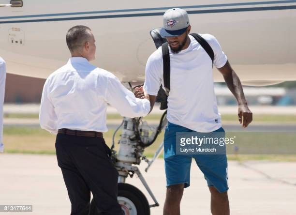 Paul George of the Oklahoma City Thunder is greeted by head coach Billy Donovan and throngs of Thunder fans on July 11 2017 at the Will Rogers...
