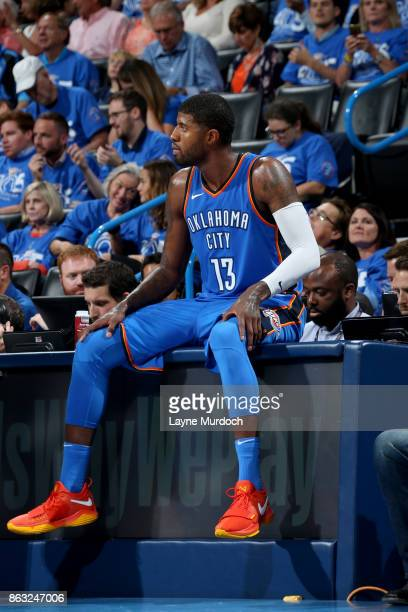 Paul George of the Oklahoma City Thunder looks on during the game against the New York Knicks on October 19 2017 at Chesapeake Energy Arena in...