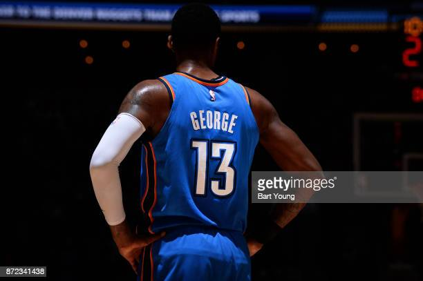 Paul George of the Oklahoma City Thunder looks on during the game against the Denver Nuggets on November 9 2017 at the Pepsi Center in Denver...