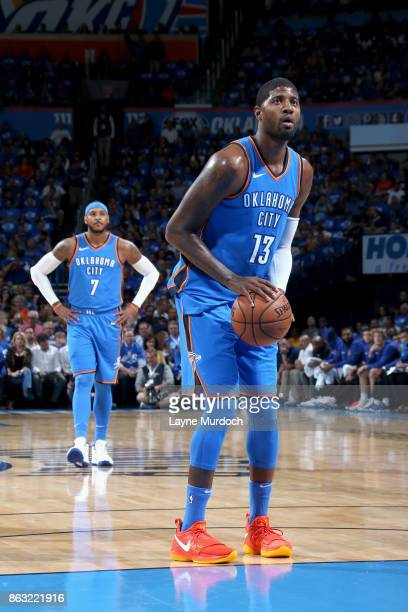 Paul George of the Oklahoma City Thunder shoots a free throw against the New York Knicks on October 19 2017 at Chesapeake Energy Arena in Oklahoma...