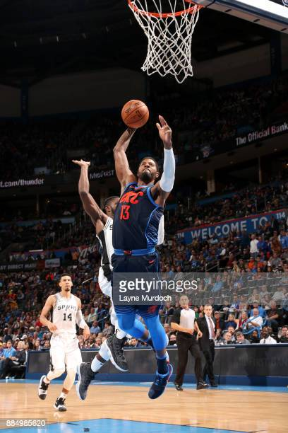 Paul George of the Oklahoma City Thunder shoots the ball against the San Antonio Spurs on December 3 2017 at Chesapeake Energy Arena in Oklahoma City...