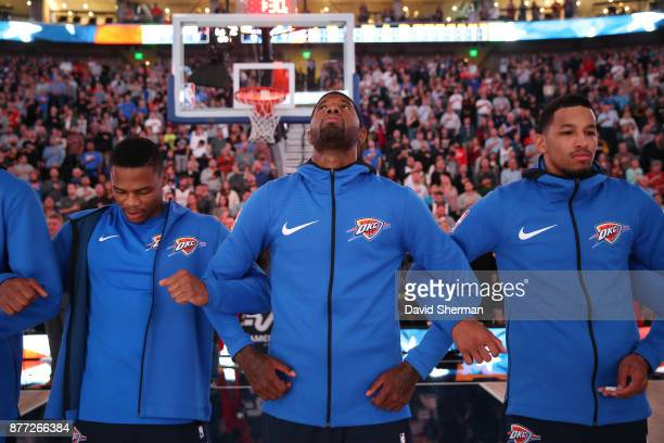 Paul George of the Oklahoma City Thunder stands for the National Anthem before the game against the Utah Jazz on October 21 2017 at Vivint Smart Home...