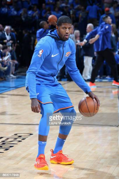 Paul George of the Oklahoma City Thunder warms up before the game against the New York Knicks on October 19 2017 at Chesapeake Energy Arena in...