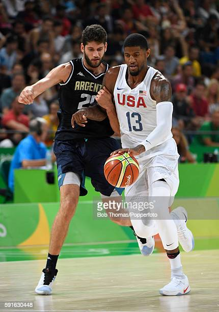 Paul George of the United States is challenged by Patricio Garino of Argentina during the United States v Argentina Men's Quarterfinal match on Day...