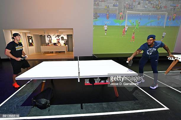 Paul George of the USA Basketball Men's National Team plays ping pong while visiting the Team Nike House during the Rio 2016 Olympic Games on August...