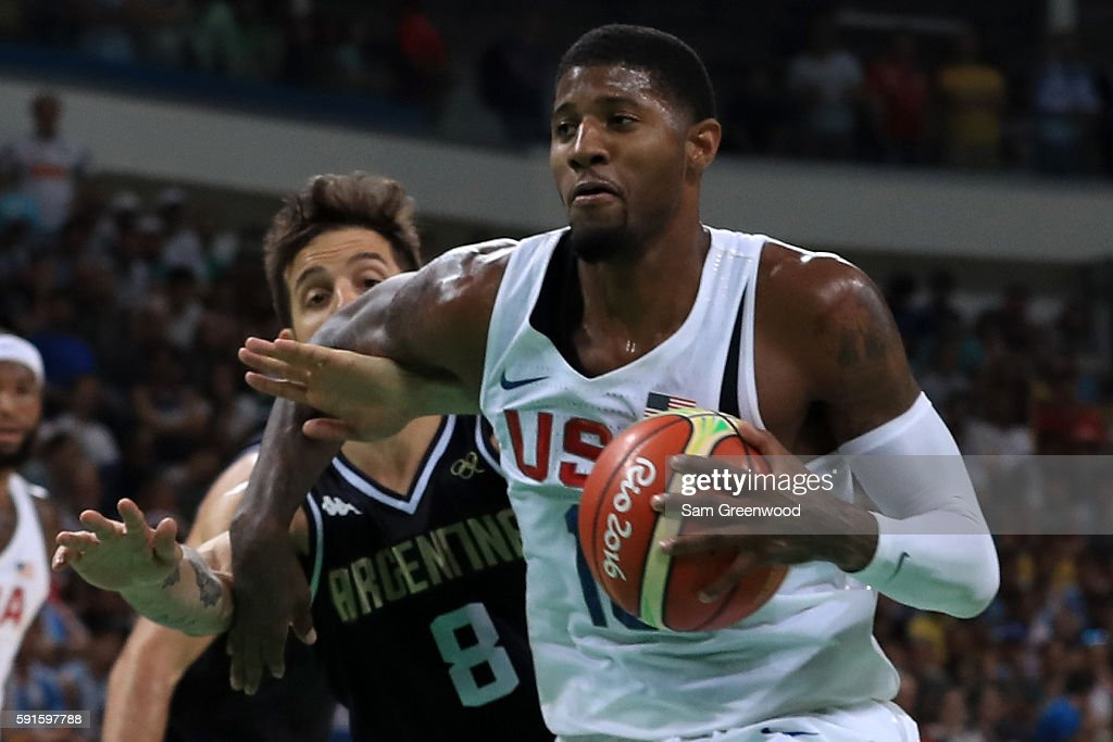 Paul George of United States drives past Nicolas Laprovittola of Argentina during the Men's Quarterfinal match on Day 12 of the Rio 2016 Olympic...