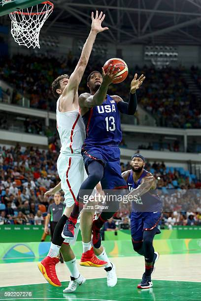 Paul George of United States goes to the basket against Pau Gasol of Spain during the Men's Semifinal match on Day 14 of the Rio 2016 Olympic Games...