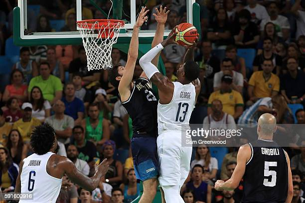 Paul George of United States shoots the ball over Patricio Garino of Argentina during the Men's Quarterfinal match on Day 12 of the Rio 2016 Olympic...