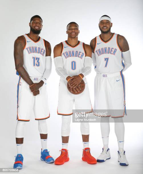 Paul George Russell Westbrook and Carmelo Anthony of the Oklahoma City Thunder pose for a portrait during the 2017 NBA Media Day on September 25 2017...
