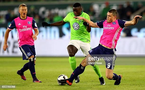 Paul Georges Ntep of Wolfsburg and Kyriakos Papadoulos of Hamburg battle for the ball during the Bundesliga match between VfL Wolfsburg and Hamburger...