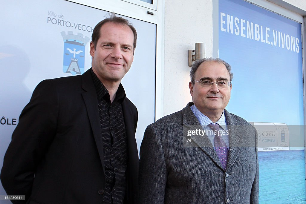 Paul Giacobbi(R),Corsica executive council president and Christian Prudhomme(L), Tour de France cycling race director pose on March 21, 2013, a hundred days before the start of the Tour de France cycling race which will start in Porto Vecchio, Corsica. AFP PHOTO / PASCAL POCHARD-CASABIANCA