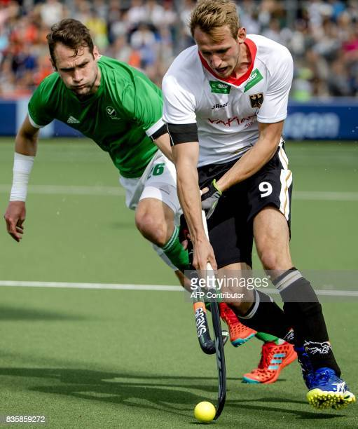 Paul Gleghorne of Ireland fights for the ball with Niklas Wellen of Germany during the men's Rabo EuroHockey Championships 2017 match between Ireland...