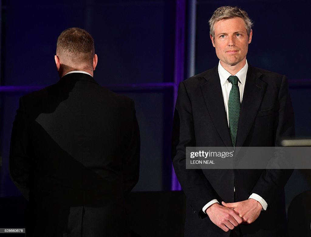 Paul Golding (L), the candidate for Mayor of London for Britain First, turns his back during a speech by the newly elected mayor of London Sadiq Khan,(not pictured) as Conservative party candidate Zac Goldsmith (R) looks on at City Hall in central London on May 7, 2016. London became the first EU capital with a Muslim mayor Friday as Sadiq Khan won the election that saw his opposition Labour party suffer nationwide setbacks. / AFP / LEON