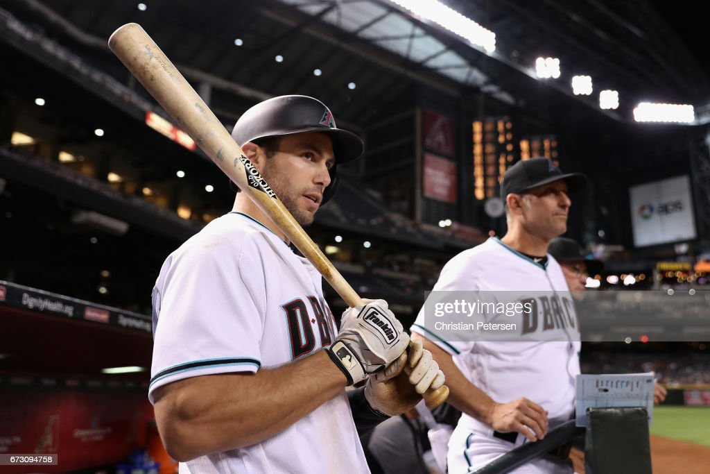 Paul Goldschmidt #44 and manager Torey Lovullo #17 of the Arizona Diamondbacks watch from the dugout during the eighth inning of the MLB game against the San Diego Padres at Chase Field on April 25, 2017 in Phoenix, Arizona.