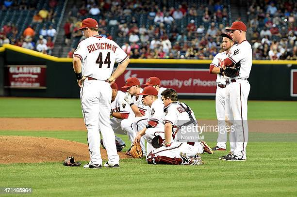 Paul Goldschmidt of the Arizona Diamondbacks and the rest of the starting lineup look on as teammate Archie Bradley is tended to on the pitchers...
