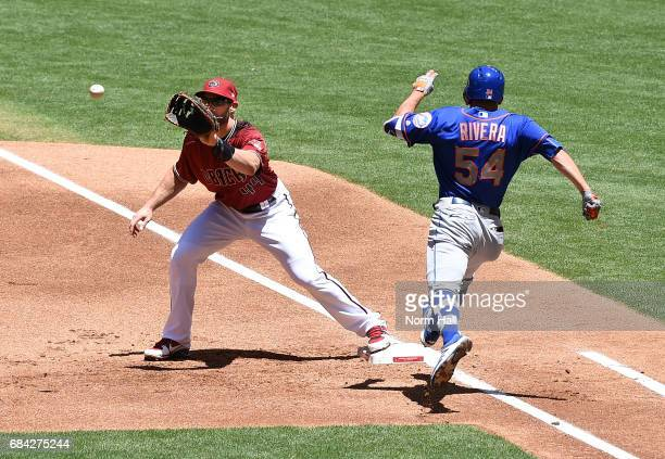 Paul Goldschmidt of the Arizona Diamondbacks catches a throw as TJ Rivera of the New York Mets is forced out at first base during the first inning at...