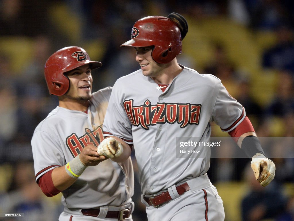 Paul Goldschmidt #44 of the Arizona Diamondbacks celebrates his two run homerun with Gerardo Parra #8 to take a 5-3 lead over the Los Angeles Dodgers during the ninth inning at Dodger Stadium on May 7, 2013 in Los Angeles, California.