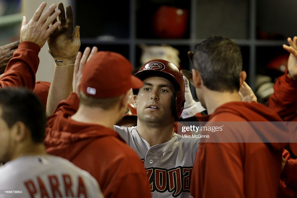 Paul Goldschmidt #44 of the Arizona Diamondbacks celebrates in the dugout after hitting a two run homer scoring Miguel Montero in the top of the fifth inning against the Milwaukee Brewers at Miller Park on April 6, 2013 in Milwaukee, Wisconsin.