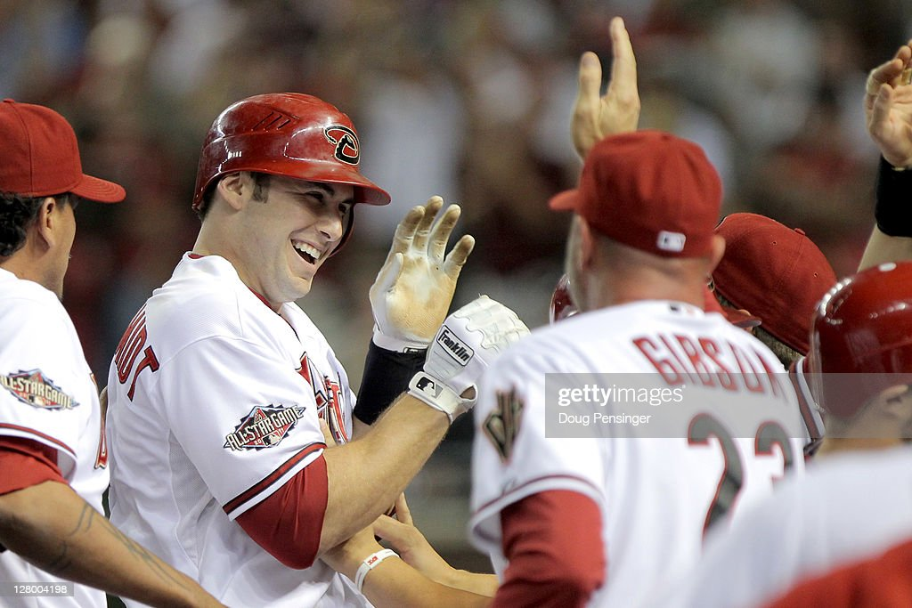 Paul Goldschmidt of the Arizona Diamondbacks celebrates with teammates at the dugout after he hits a grand slam in the fifth inning off pitcher Shaun...