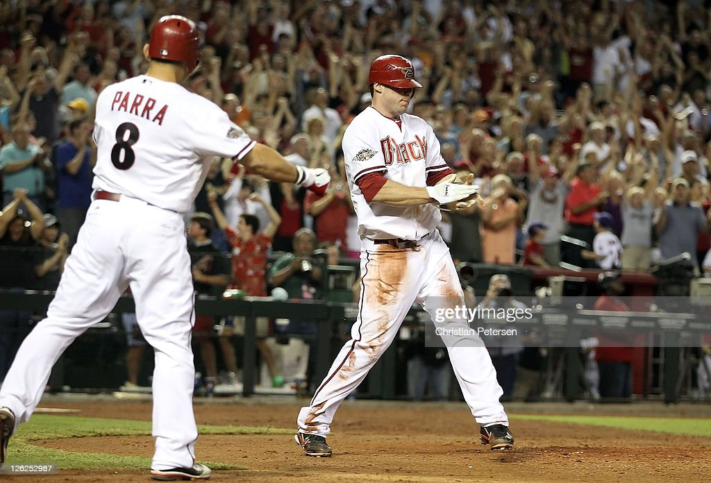 Paul Goldschmidt of the Arizona Diamondbacks celebrates with Gerardo Parra after scoring a run against the San Francisco Giants during the seventh...