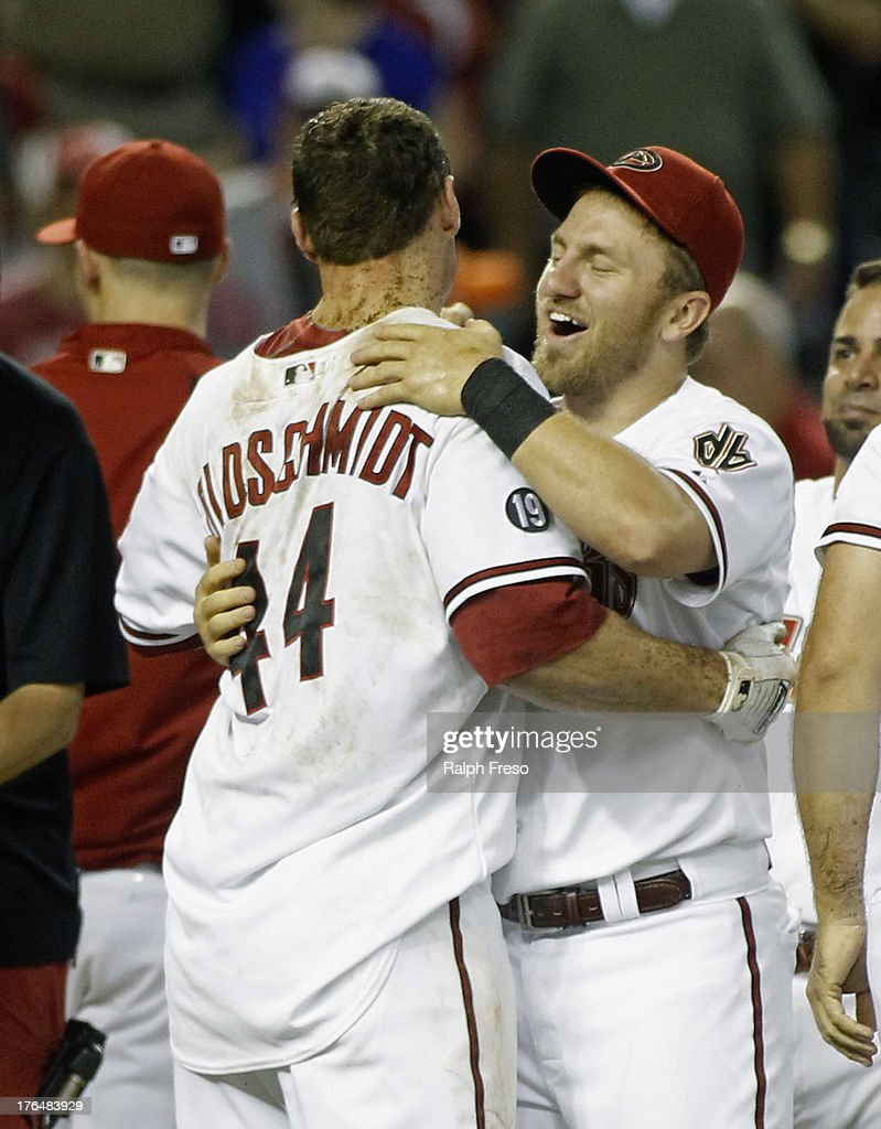 <a gi-track='captionPersonalityLinkClicked' href=/galleries/search?phrase=Paul+Goldschmidt&family=editorial&specificpeople=7511120 ng-click='$event.stopPropagation()'>Paul Goldschmidt</a> #44 of the Arizona Diamondbacks celebrates with teammate Cliff Pennington #4 following his game-winning walk off home run against the Baltimore Orioles in the eleventh inning of a MLB game at Chase Field on August 13, 2013 in Phoenix, Arizona. The Diamondbacks defeated the Orioles 4-3.