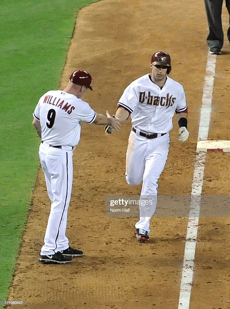 <a gi-track='captionPersonalityLinkClicked' href=/galleries/search?phrase=Paul+Goldschmidt&family=editorial&specificpeople=7511120 ng-click='$event.stopPropagation()'>Paul Goldschmidt</a> #44 of the Arizona Diamondbacks celebrates with third base coach Matt Williams #9 after hitting his second home run of the game against the Cincinnati Reds at Chase Field on June 21, 2013 in Phoenix, Arizona.