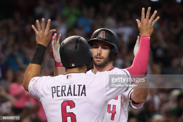 Paul Goldschmidt of the Arizona Diamondbacks high fives David Peralta after hitting a two run home run against the Pittsburgh Pirates during the...